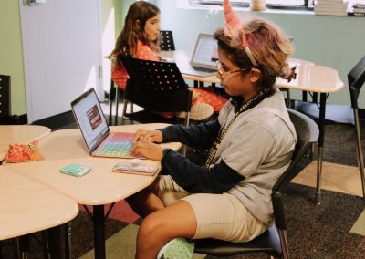 girls working independently on coding projects