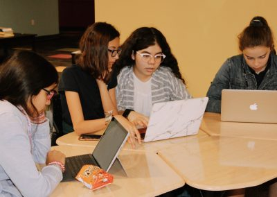 girls working together on coding projects