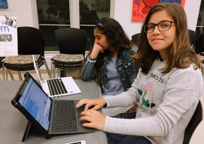 girls smiling and coding