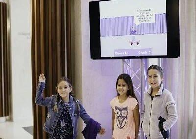 students in front of digital exhibit