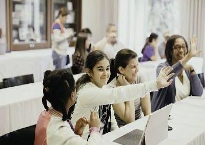 student raising hand in workshop