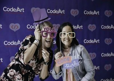 girls with props at photobooth