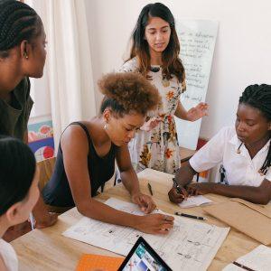 girls working on a hackathon